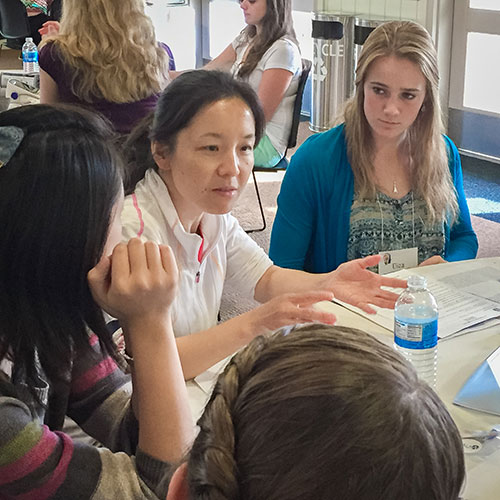 Professor Jing Xu's work in biology drew many of the girls' interest.
